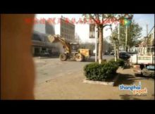 Chinese construction workers brawl in bulldozers